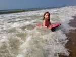 One of my proudest parenting moments:  Elizabeth overcoming her fear and riding a wave.