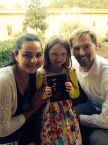 Elizabeth (center) holding her STAR3 Student plaque, standing next to her teacher, Senorita Jimenez.